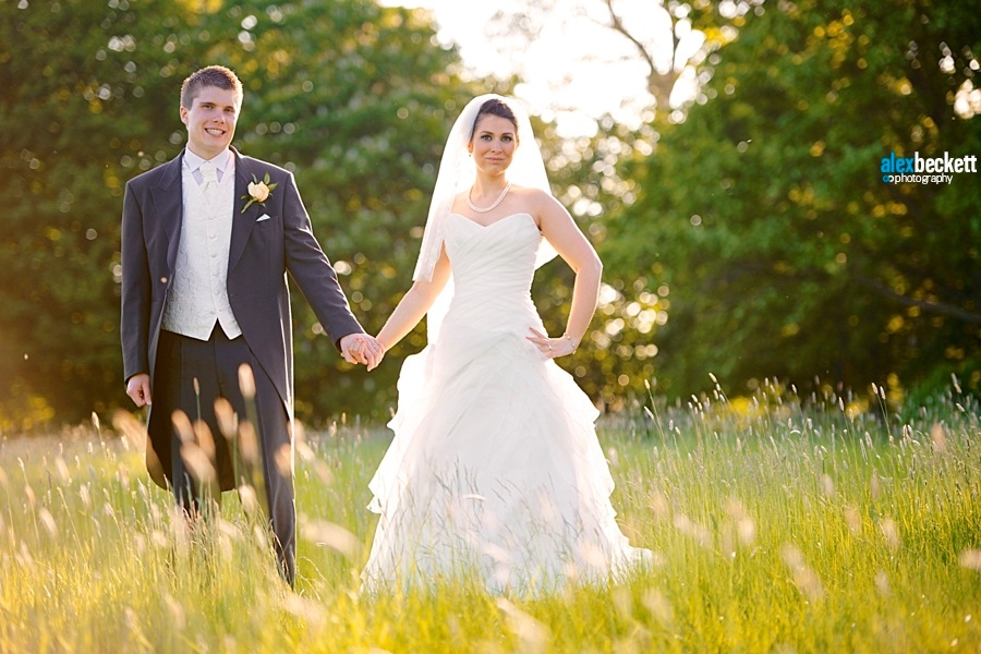 1 Sunset wedding photo in a field at the Fennes Estate Bocking