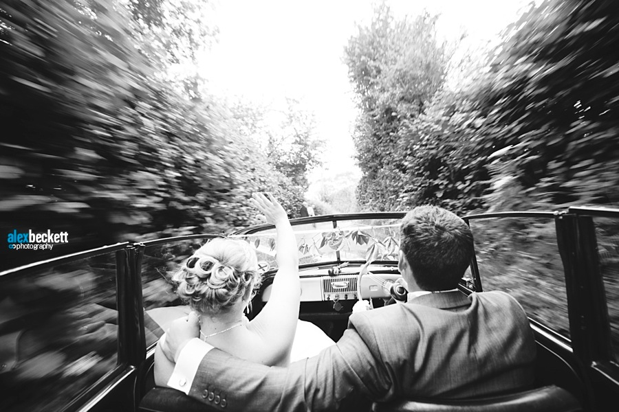 AB 044 Wedding Drive through the country Bride and Groom Moris Minor Great barn Rolvenden