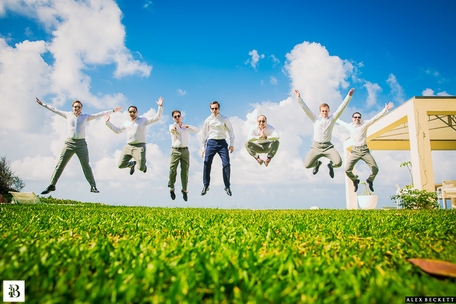 AlexBeckett-45 Destination Wedding Photographer Groomsmen Jump caribbean
