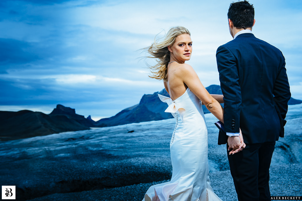 Best UK Wedding Photographer Iceland Glacier Alex Beckett Bride and Groom Dramatic Moody
