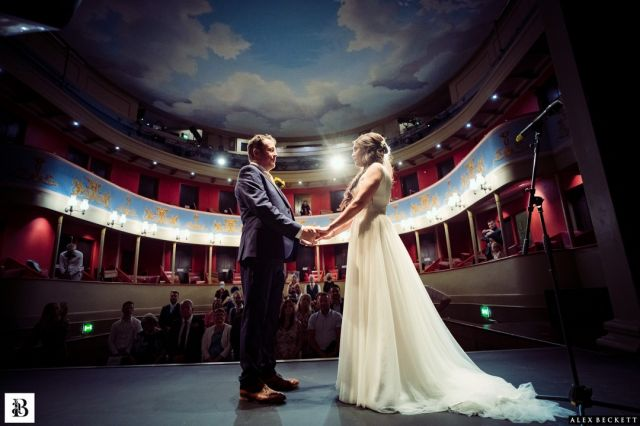 The Theatre Royal, Bury St Edmunds, is a perfect Regency theatre and the most amazing, different, dramatic setting for the wedding ceremony of Linda and Karl. Had such a fun day the other Saturday with these two!  @theatreroyalbse #suffolkweddingphotography #theatreroyalbury #theatreroyalbse #burystedmundswedding #theatrewedding #contemporarywedding #weddingwithadifference #fearlessphotography