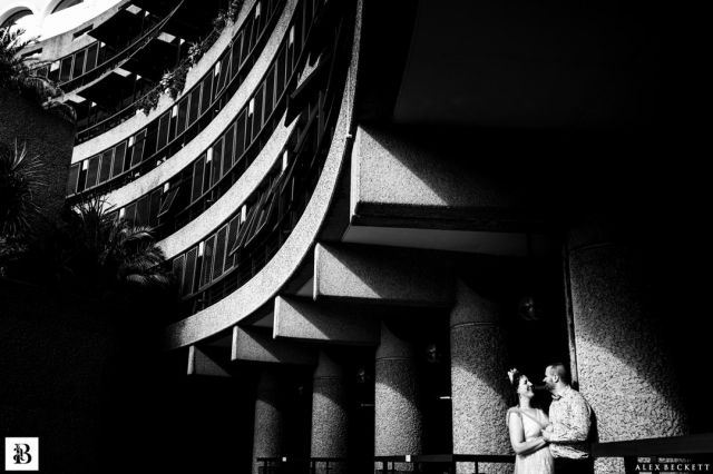 Really enjoyed myself capturing the very colourful and fun Barbican Conservatory wedding of Hannah and Daniel but I've chosen a black and white couple shot against that amazing architecture! Happy first week anniversary for tomorrow, guys!  @hjb31  @daniel_neilson_82 @rosesavagebridal @barbicancentre  #londonweddingphotographer #blackandwhitewedding #barbicanconservatory #barbicanconservatorywedding #urbanromance